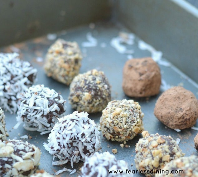 Super creamy dark chocolate truffles. Tons of options to coat these bites of chocolate heaven! Recipe at http://www.fearlessdining.com