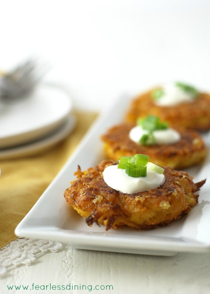 Gluten Free Delicata Squash Cheddar Fritters on a serving platter