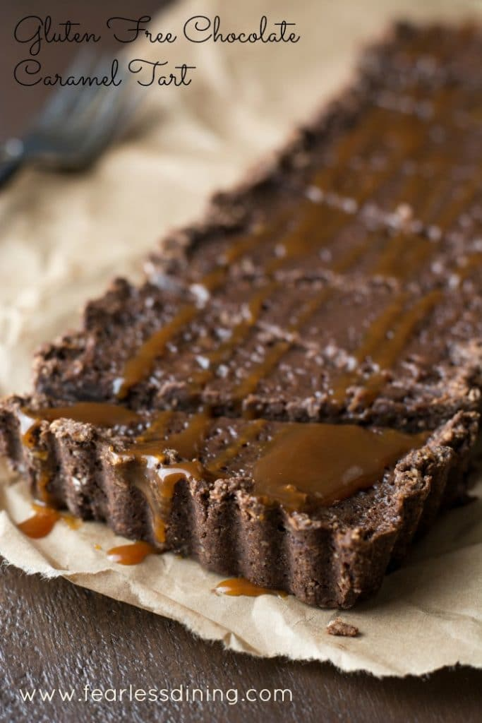 Gluten Free Chocolate Caramel Tart on a paper bag