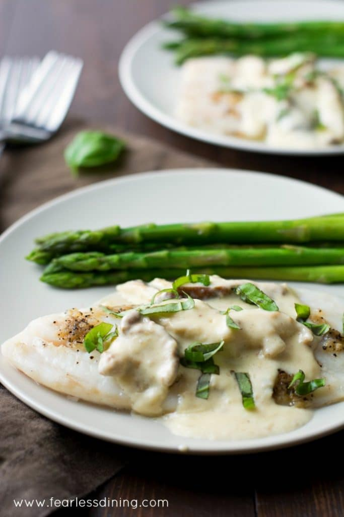 Tilapia with Shiitake Alfredo Sauce is a quick and easy dinner in under 30 minutes. Found at http://www.fearlessdining.com