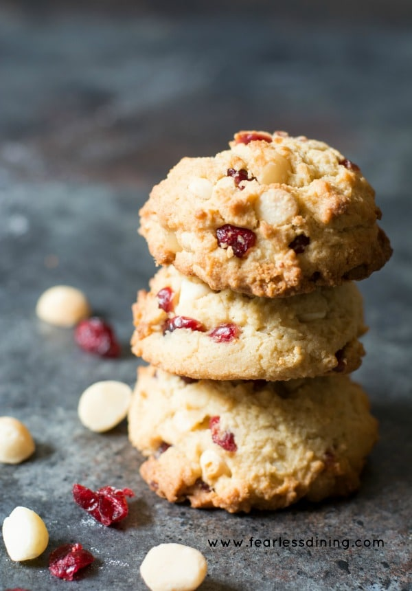 Gluten Free Cranberry White Chocolate Chip Cookies stacked on top of each other