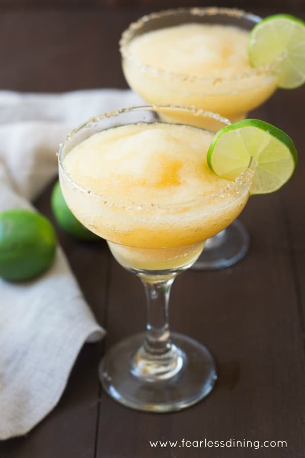 Frozen Peach Margaritas with a Ginger Sugar Rim - Fearless Dining