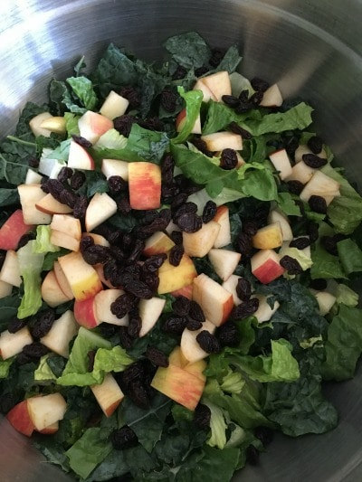 Kale salad ingredients in a bowl