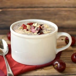 Coconut Chia Pudding with Cherries in a white mug