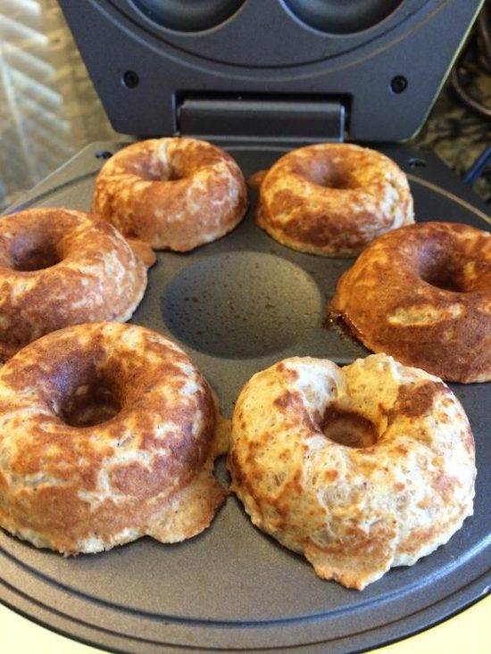 cooked donuts that are cooked and in the donut maker