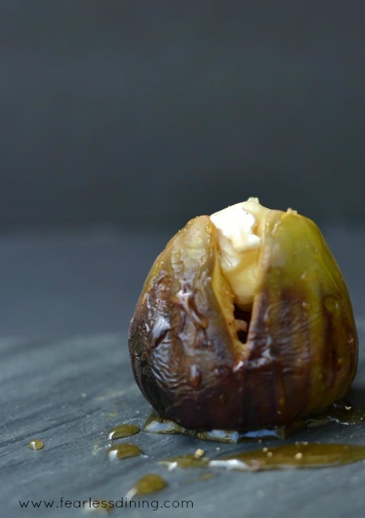 Single Grilled Brie Stuffed Fig with honey drizzled on top