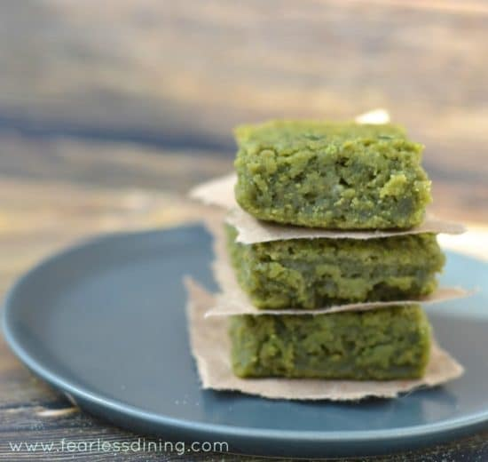 A grey plate with three Matcha Green Tea Mochi squares on top of each other