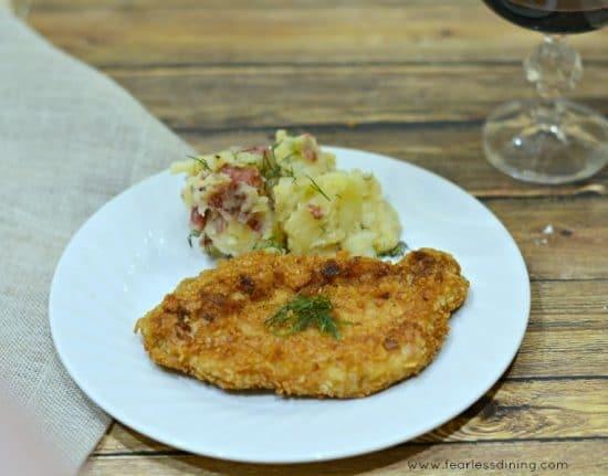 Gluten Free Pork Schnitzel with German potato salad on a plate