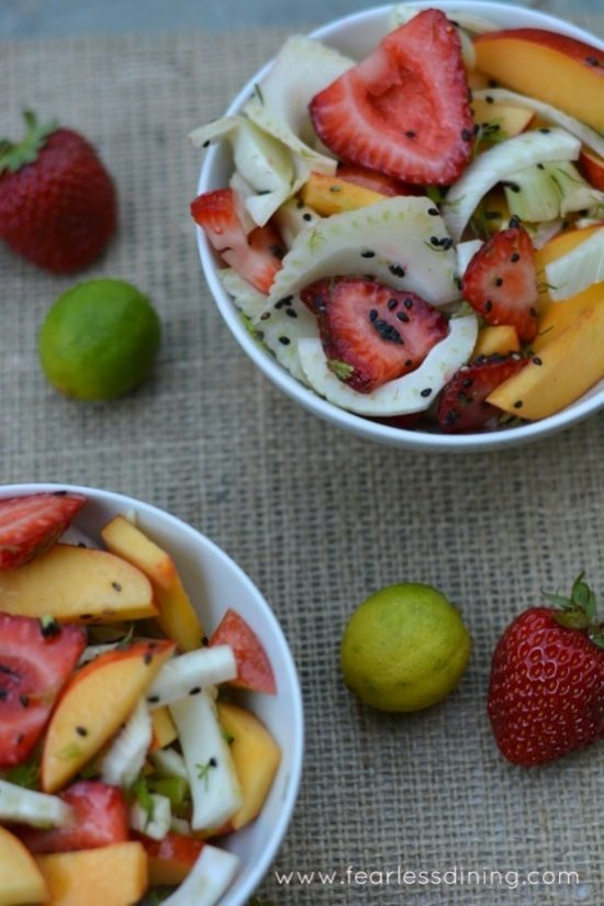 Two bowls Fennel Salad with fresh strawberries and nectarines