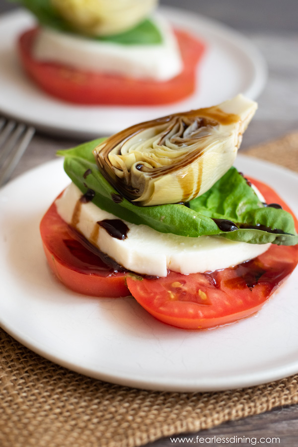 a stacked heirloom tomato salad on a plate
