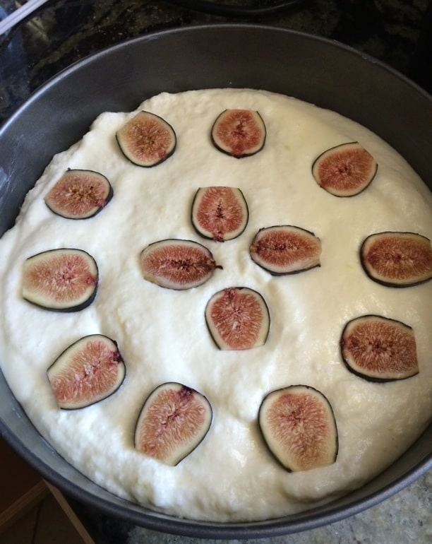 lemon yogurt cake batter in a springform pan with fresh figs on top
