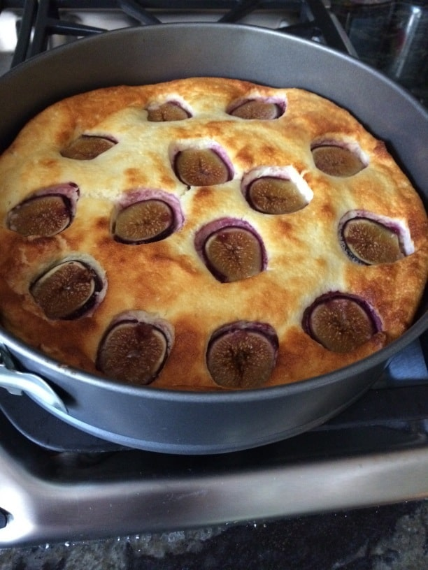 Fig cake puffed up as it bakes in the oven