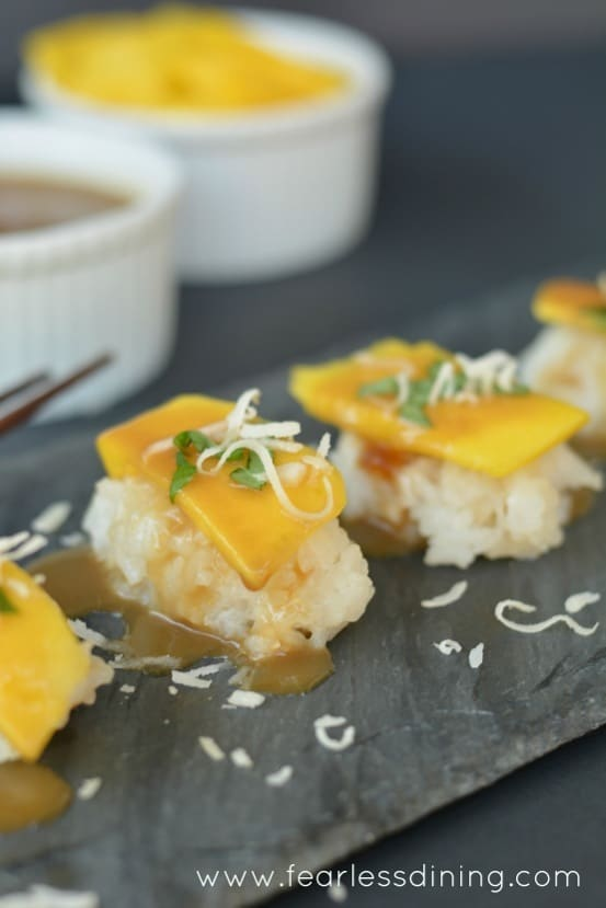 Mango and Coconut Dessert Sushi on a slate tray