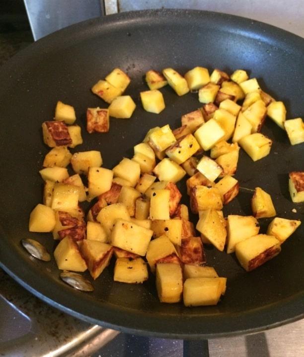 delicata squash cubes sauteing in a pan