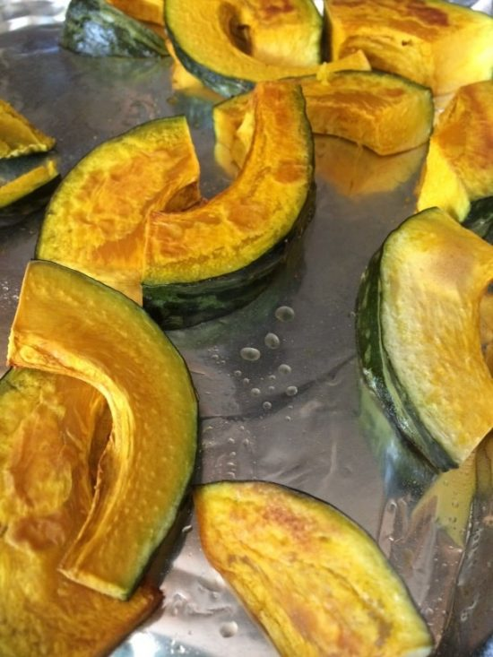 kabocha squash slices roasted on a baking tray