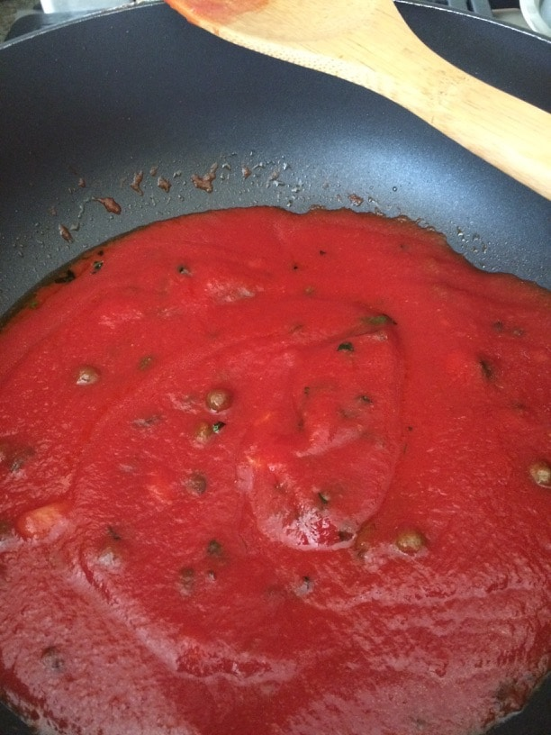 homemade marinara sauce simmering in a pan