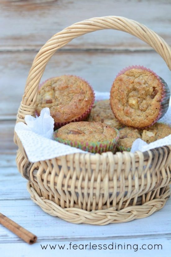 Paleo Pear Cinnamon Muffins in a wicker basket