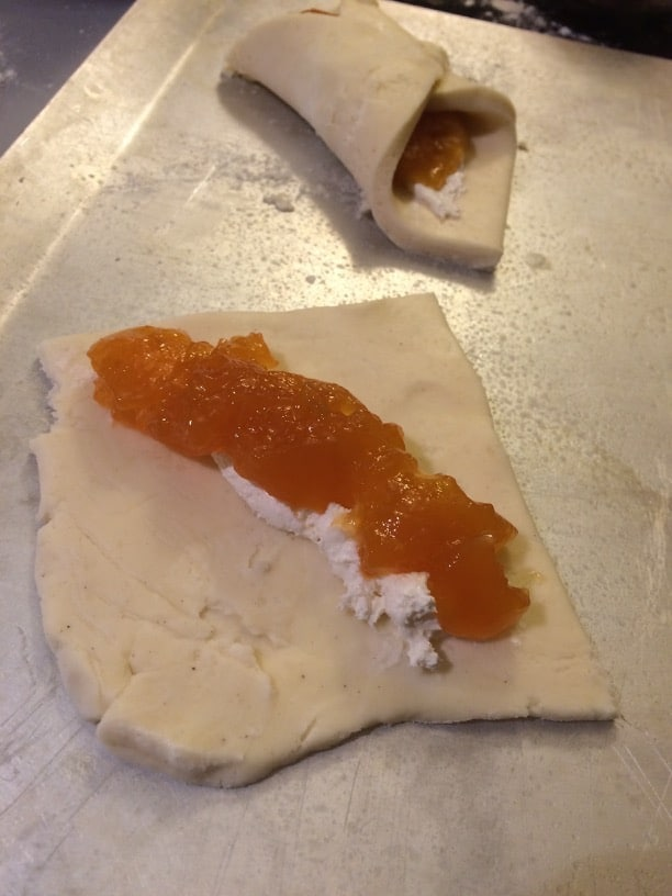 Adding jam to the gluten free pastry dough to make gluten free pastries