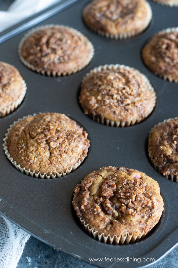 a close up of the gluten free cinnamon streusel muffins in a pan