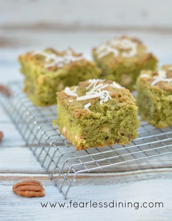 Gluten Free Matcha Coconut Cookie Bars on a cooling rack.