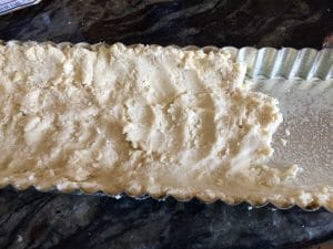 Shape the pie crust in the tart pan.