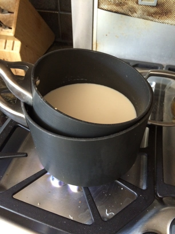 Using two pots as a double boiler to make homemade tapioca pudding