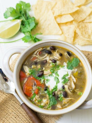 a bowl of chicken taco soup with tortilla chips
