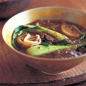Bok Choy and Beef Noodle Soup in a brown bowl
