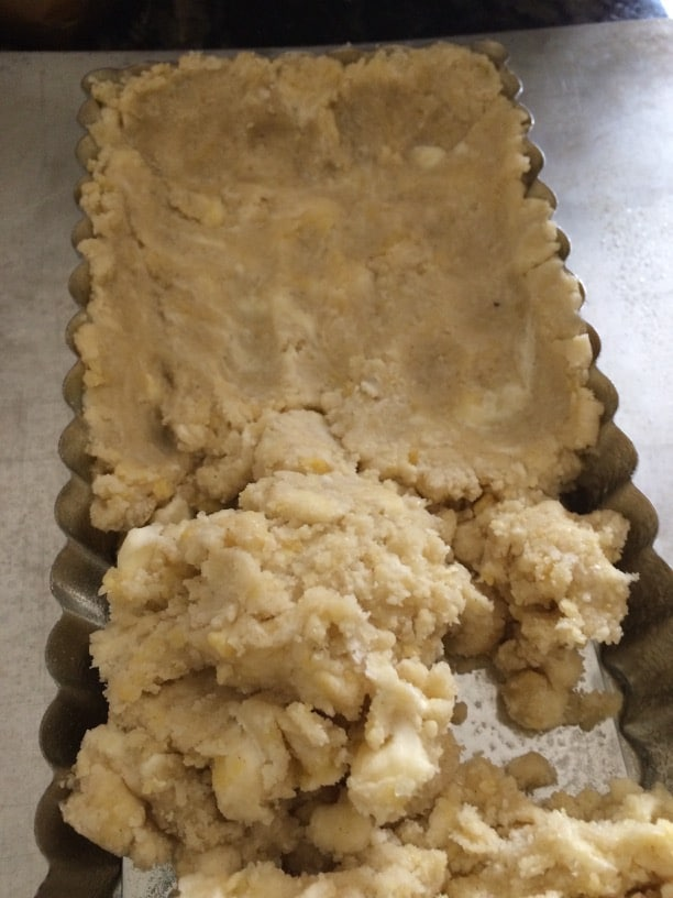 pressing crust dough into a tart pan