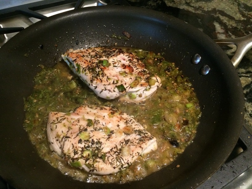 chicken breasts in a frying pan saute in shishito sauce