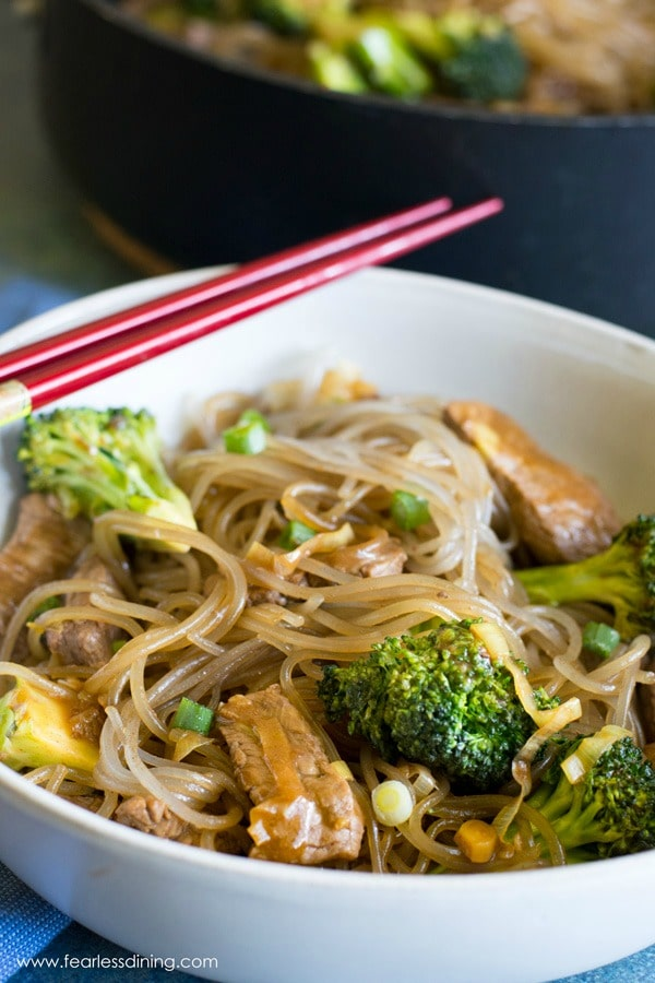A close up of a bowl of beef and broccoli stir-fry with noodles.