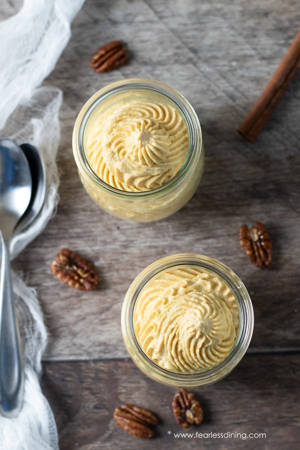 top view of two bowls of pumpkin mousse