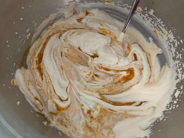 mixing gently the pumpkin and whipped cream