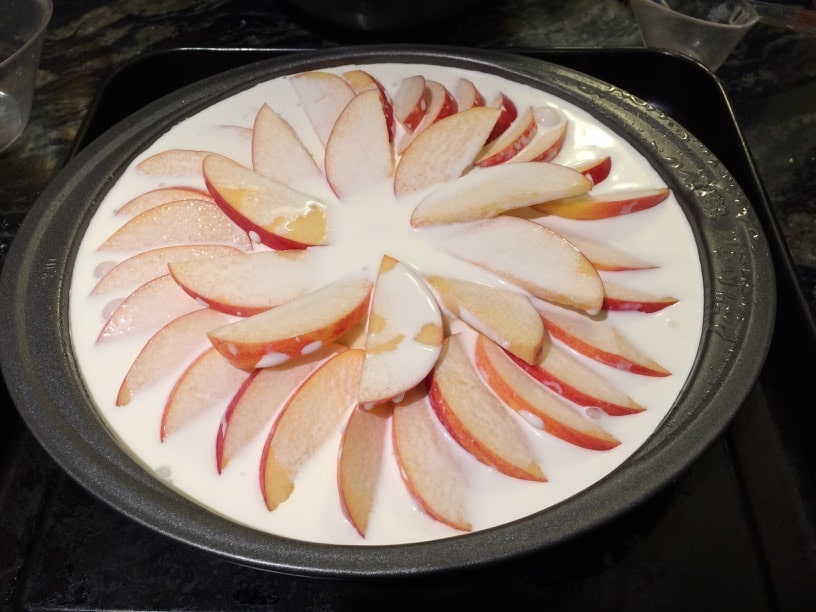 Apple cake in a pan ready to bake