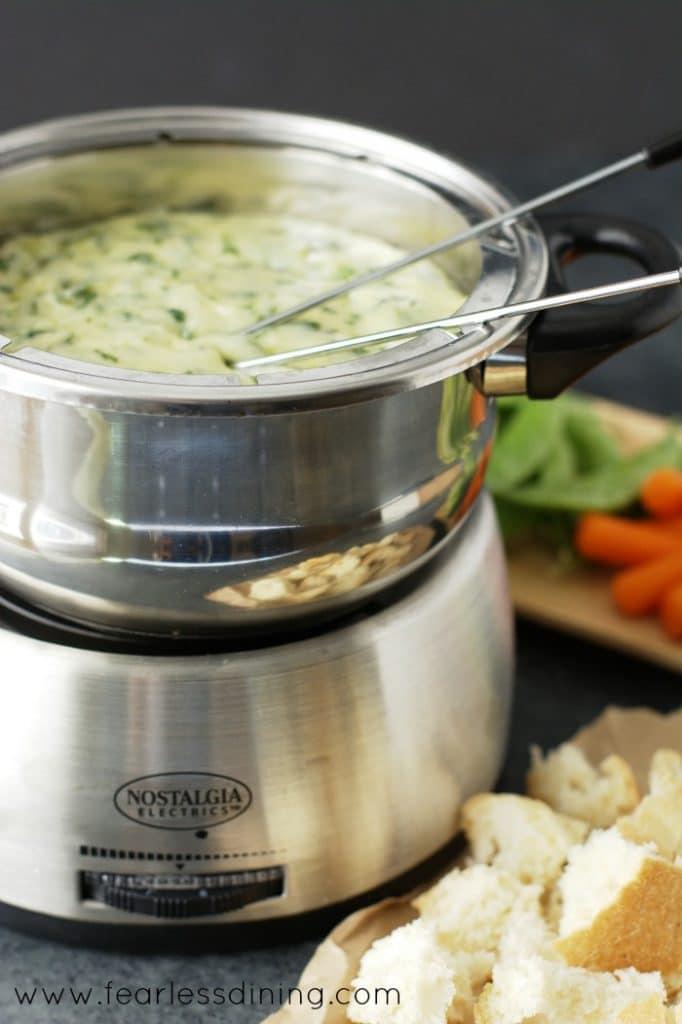 Gluten Free Spinach and Leek Cheese Fondue in a fondue melting pot