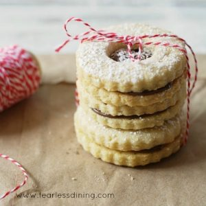 Gluten Free Nutella Linzer Cookies in a stack tied with a string