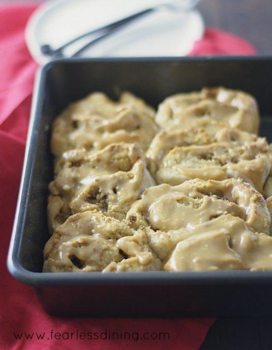 A baking dish full of Gluten Free Peanut Butter Cinnamon Rolls