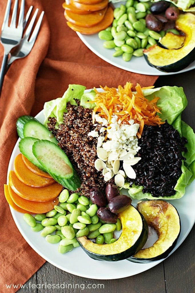 Plates with Black Rice, Quinoa, cucumber, edamame, carrots and persimmon.