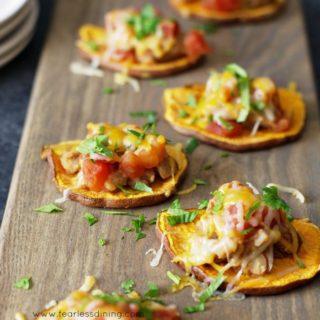 Sweet potato nachos on a wood cutting board
