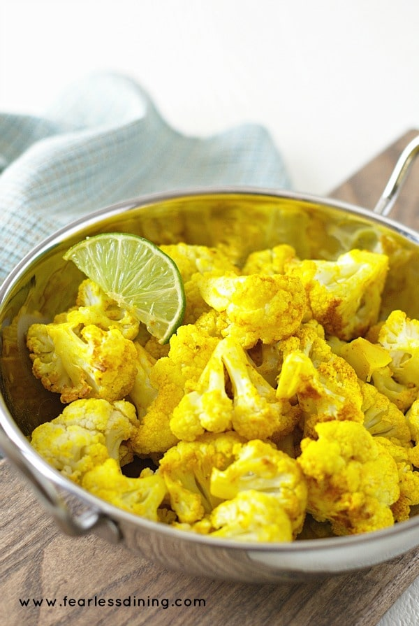 Curried Turmeric Cauliflower in a silver serving bowl