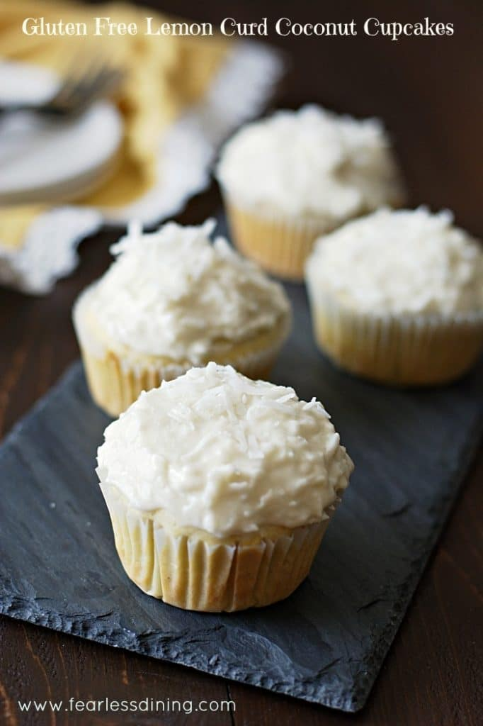 Gluten Free Lemon Curd Coconut Cupcakes on a slate tray