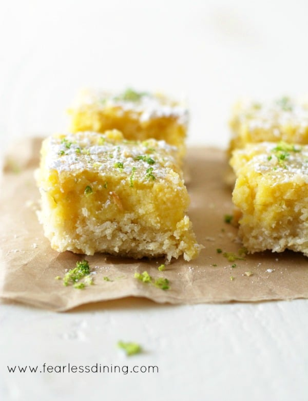 cut lime bars sitting on a brown napkin