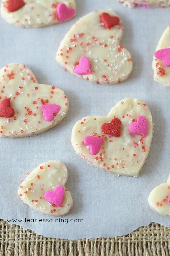 Close up of White Chocolate Fudge Bites. Each has pink and red heart sprinkles on top