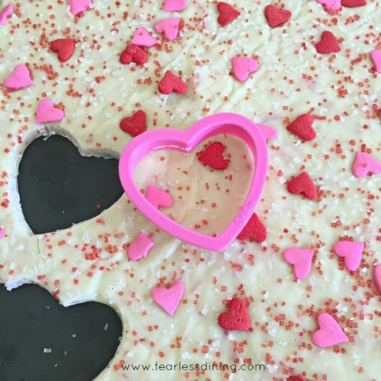 Minty White Chocolate Fudge Bites cut out with a heart shaped cookie cutter.