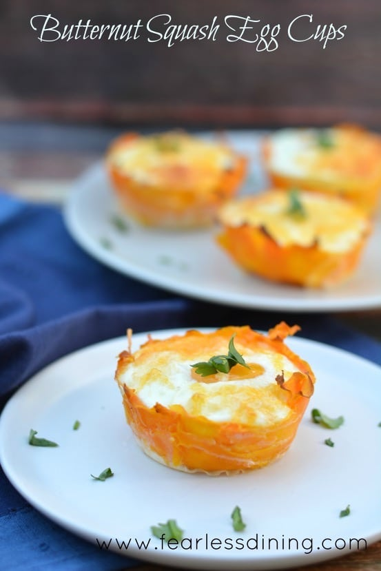 Paleo Butternut Squash Egg Cups on a plate with a blue napkin in the background