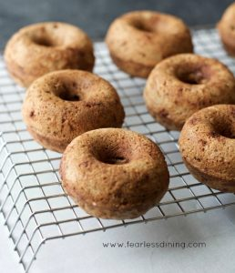 Chocolate Orange Donuts on a cooling rack. The donuts have not been frosted yet.