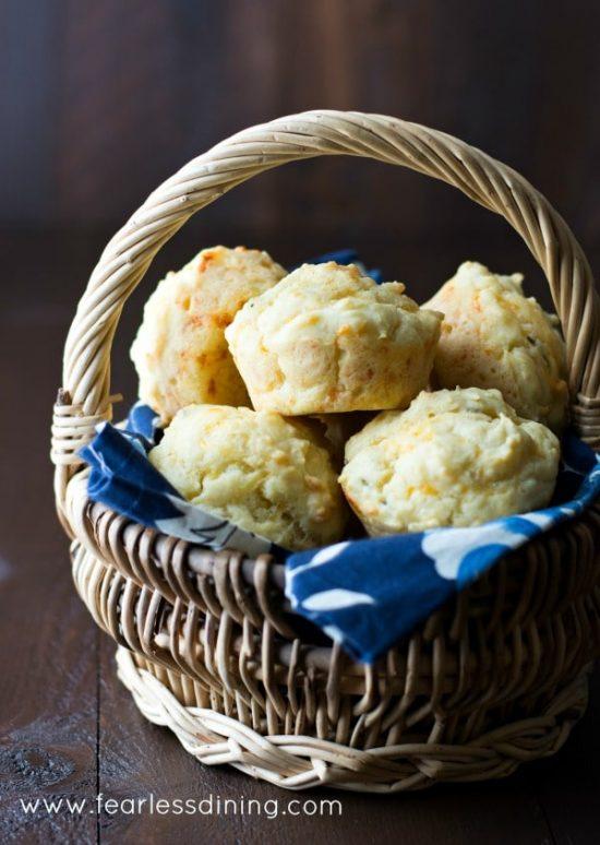 a basket of gluten free cheddar herb muffins