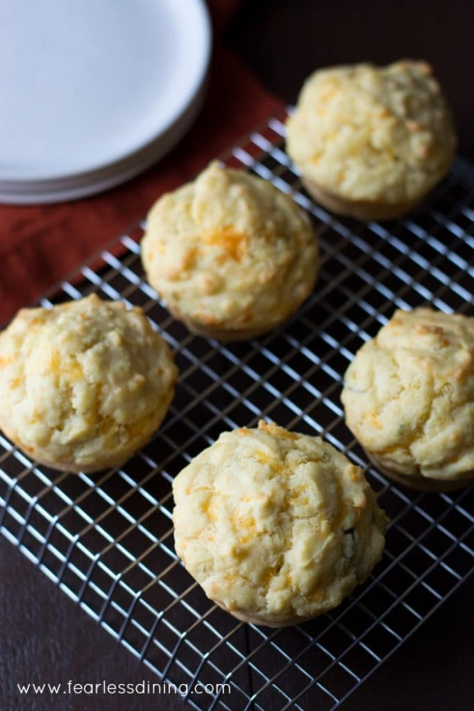 Gluten Free Cheddar Herb Muffins on a cooling rack