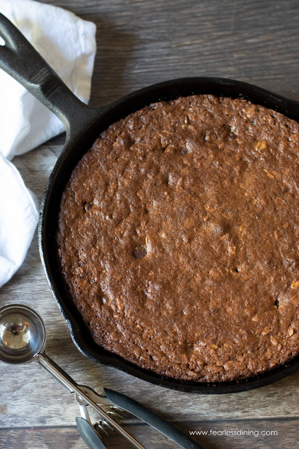 A giant oatmeal cookie baked in a cast iron skillet