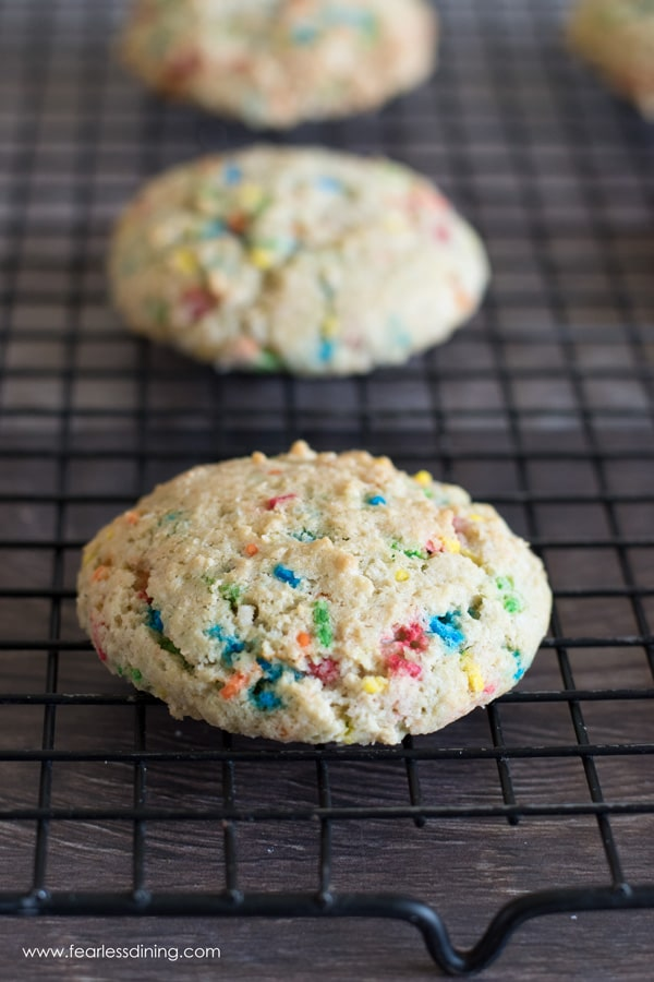 funfetti cookies on a black cooling rack